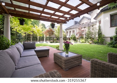 Photo of luxury garden furniture at the patio - stock photo