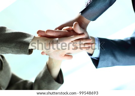 Photo of male and female hands making pile - stock photo