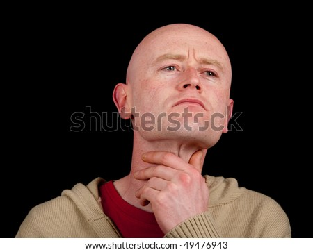 photo of male holding is throat on black backdrop - stock photo