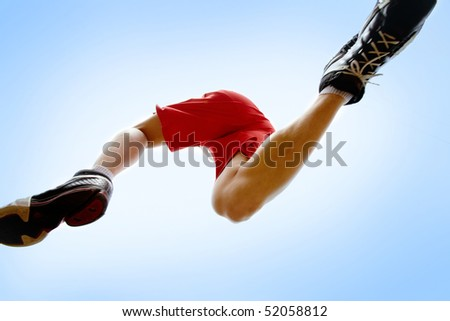 Photo of male runner with blue sky above - stock photo