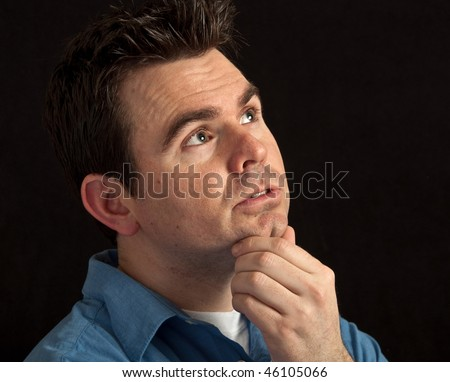 photo of male under stress and worried on black - stock photo