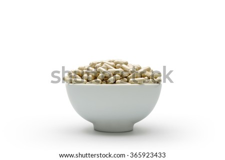 Photo of Medicine , Capsules in Bowl With White Background - stock photo