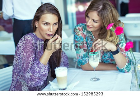 Photo of meeting of friends in restaurant - stock photo