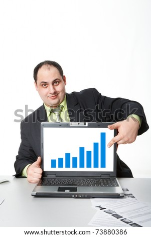 Photo of middle aged employer showing thumb up while pointing at chart on laptop screen - stock photo
