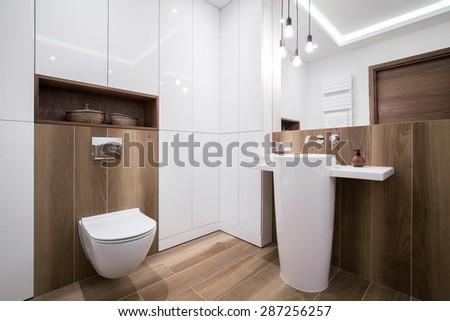 Photo of modern cozy wooden bathroom - stock photo