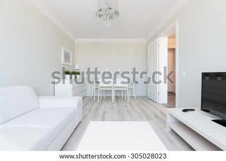 Photo of modern style flat interior with white furniture - stock photo