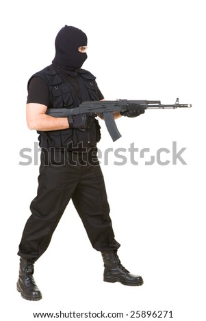 Photo of murderer with gun attacking someone while pointing it forwards - stock photo