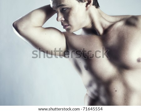 Photo of naked athlete with strong body - stock photo
