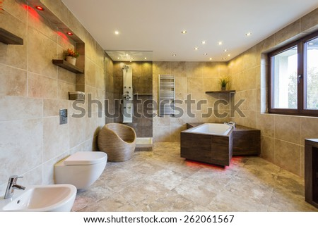 Photo of new luxury bathroom with marble floor - stock photo