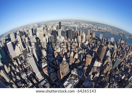 Photo of New York city taken from the Empire State Building with a fisheye lens. - stock photo