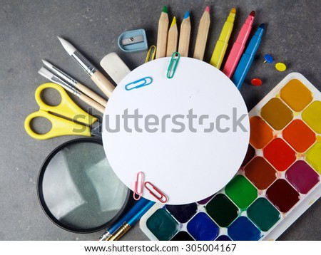 Photo of office and student gear over white background - Back to school concept - stock photo