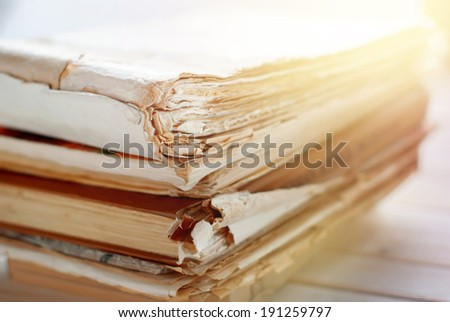Photo of Old Books with Ragged Pages, close up - stock photo