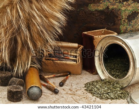 Photo of old matches for hunting with fox brush and gunpowder at beige - stock photo