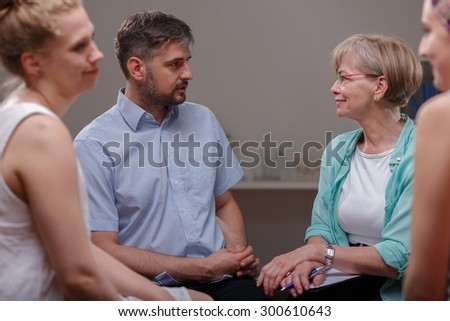 Photo of patients talking with psychologist about their problems - stock photo