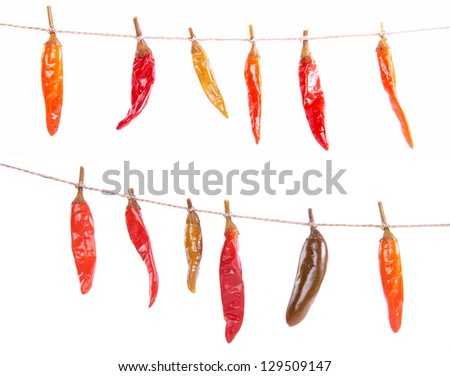 Photo of pickles peppers isolated on white - stock photo