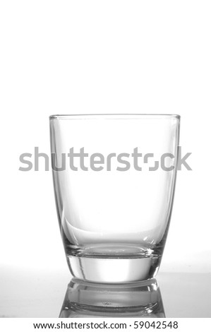 photo of pouring water and glass on white background - stock photo