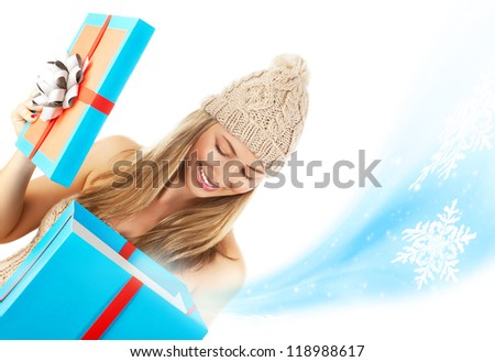Photo of pretty blond woman in stylish winter hat opened big blue present box, beautiful girl receive Christmas gift, happy young lady holding magic giftbox isolated on white background, New Year eve - stock photo