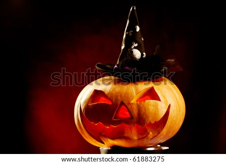 Photo of pumpkin in hat with red backlight - stock photo