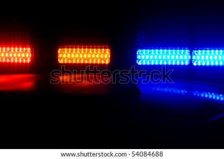 Photo of red and blue LED police roof lights on a police cruiser - stock photo