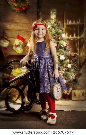 Photo of red-haired girl in a Christmas interior - stock photo
