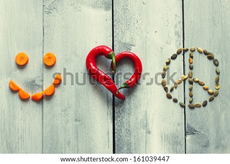 Photo of red heart shape chili pepper - stock photo