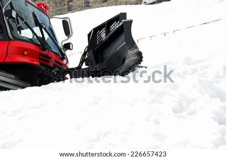 Photo of red snowgroomer in winter - stock photo