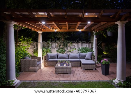 Photo of relaxing area outside of mansion at night - stock photo