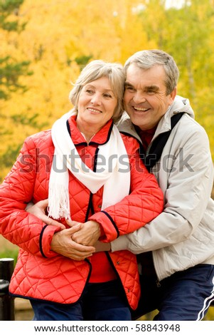 Photo of senior couple spending free time in autumn forest - stock photo
