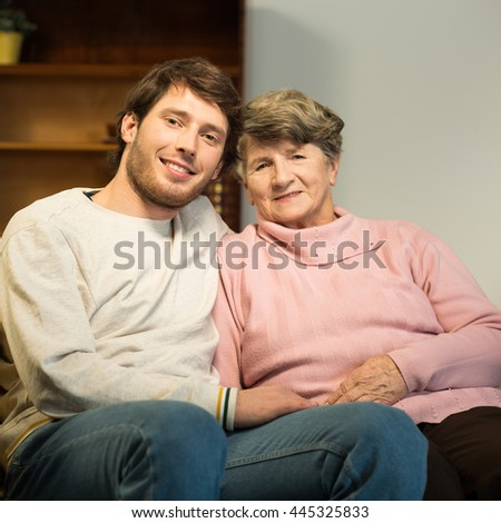 Photo of senior lady and her young male carer - stock photo
