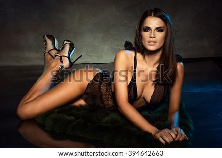 Photo of sensual attractive brunette woman . Elegant style. - stock photo
