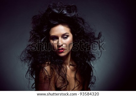 Photo of sexy beautiful woman with magnificent hair - stock photo