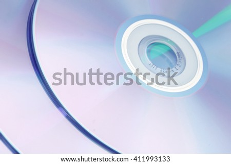 Photo of shiny underside of cd dvd cd-rom disk reflecting multicolors  - stock photo