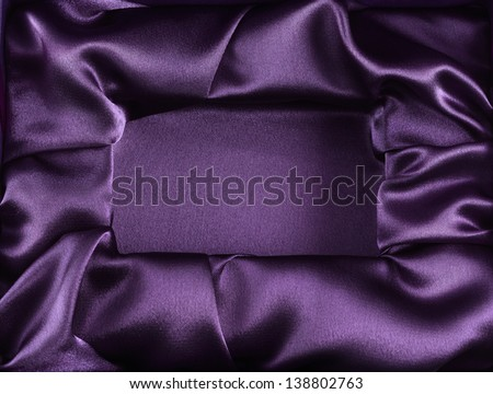 Photo of silk opened box as texture background top view - stock photo