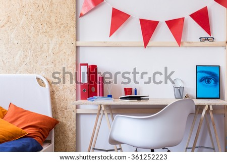 Photo of simple study area in contemporary boy room - stock photo