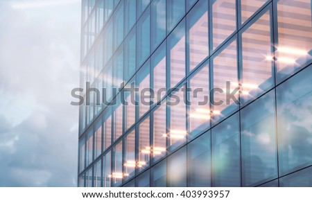 Photo of skyscraper tower. Modern office interior in evening time.Panoramic windows facade background, contemporary business center.Empty meeting room.Real horizontal mockup,flares. 3d rendering - stock photo