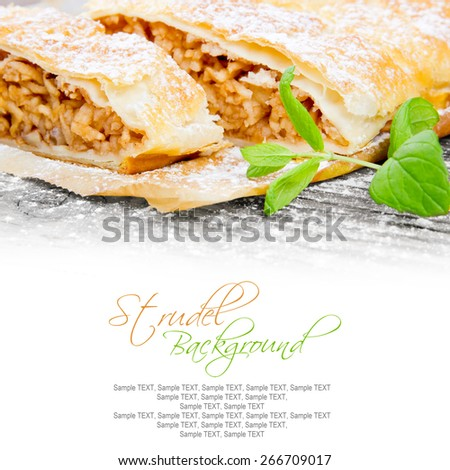 Photo of sliced apple strudel on wooden board with white space for text - stock photo