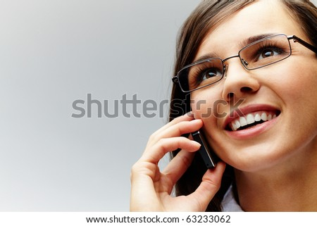 Photo of smart businesswoman talking by mobile phone in isolation - stock photo
