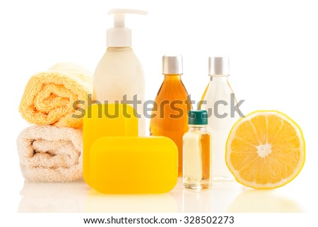 Photo of spa products with lemon over white isolated background - stock photo
