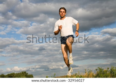 Photo of sportsman training in the forest - stock photo