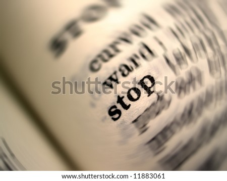 photo of  stop  word in dictionary - stock photo