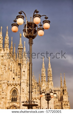 Photo of street lights in Milan, Italy, Milan Cathedral, also known as Duomo Di Milano on the background - stock photo