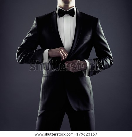Photo of stylish man in elegant black suit - stock photo