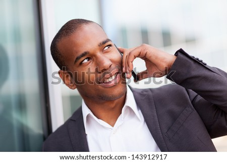 photo of successful african businessman phoning while smiling - stock photo