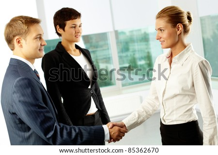 Photo of successful business partners handshaking at meeting - stock photo