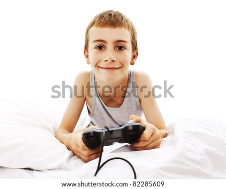 Photo of the boy with joystick playing computer game - stock photo