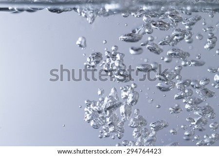 Photo of the clean water with bubbles - stock photo