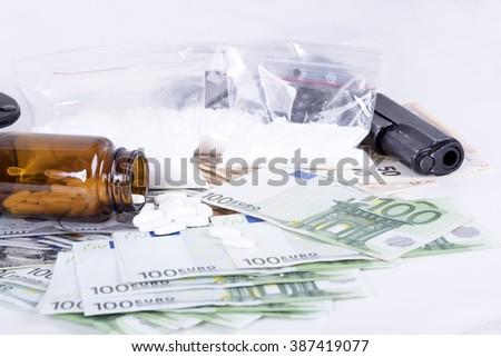 photo of the drugs, cocaine , money and gun - stock photo