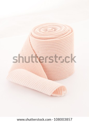 photo of the elastic bandage against the white background - stock photo