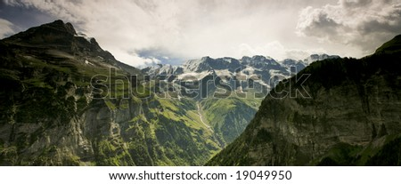 Photo of the Swiss Alps taken from the town of Gimelwald. - stock photo