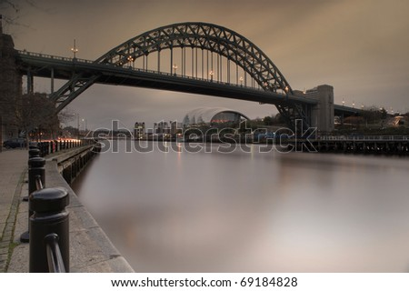 Photo of the Tyne Bridge at Newcastle upon Tyne/Gateshead, England. This shot has not been digitally manipulated - it was achieved by using a neutral density filter and a tobacco grad filter. - stock photo
